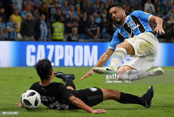 Erick Sanchez of CF Pachuca and Edilson of Gremio clash during the FIFA Club World Cup UAE 2017 semi-final match between Gremio FBPA and CF Pachuca...