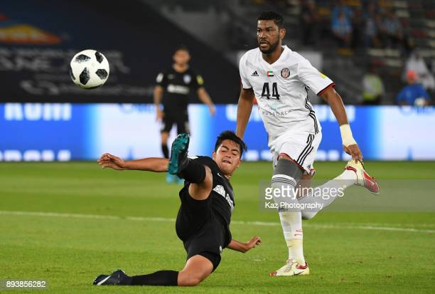Erick Sanchez of CF Pachuca missed the chance to score while Fares Juma of Al Jazira watches the ball on December 16 2017 in Abu Dhabi United Arab...