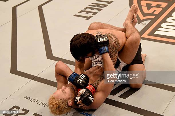 Erick Silva of Brazil and Josh Koscheck of the United States in their welterweight bout during the UFC Fight Night at Maracanazinho Gymnasium on...