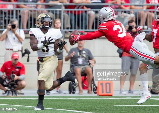 Erick Smith of the Ohio State Buckeyes breaks up a pos to Kell Walker of the Army Black Knights during the second half of the game between the Ohio...
