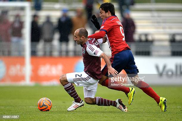 Erick Torres of Chivas USA gets physical with Nick LaBrocca of Colorado Rapids during the second half Chivas USA defeated the Colorado Rapids 31 on...