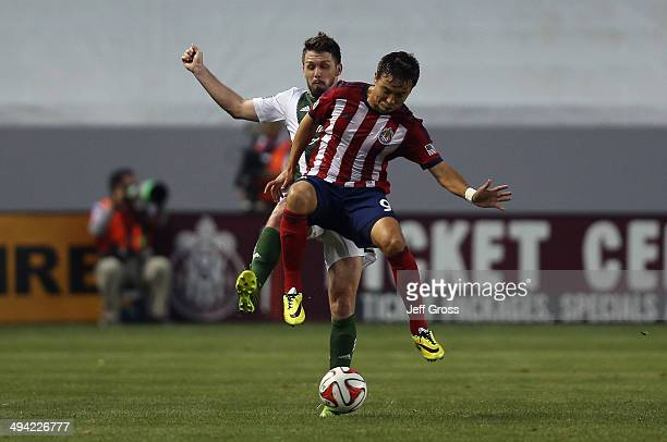 Erick Torres of Chivas USA is challenged by Danny O'Rourke of Portland Timbers for the ball in the first half at StubHub Center on May 28 2014 in Los...