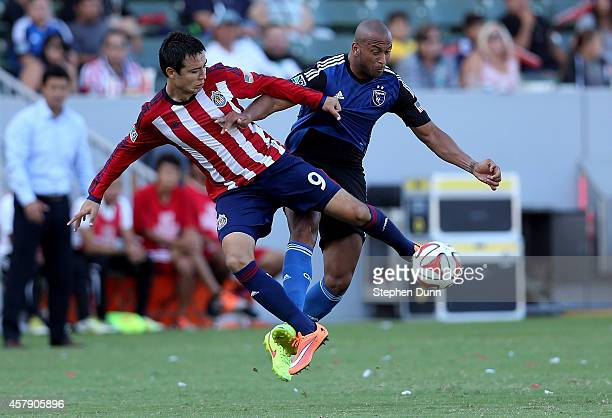 Erick Torres of Chivas USA jumps to clear the ball away from Victor Bernardez of the San Jose Earthquakes at StubHub Center on October 26 2014 in Los...