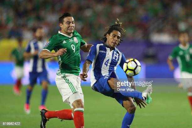 Erick Torres of Mexico and Henry Figueroa of Honduras compete for the ball during the CONCACAF Gold Cup 2017 quarterfinal match between Mexico and...