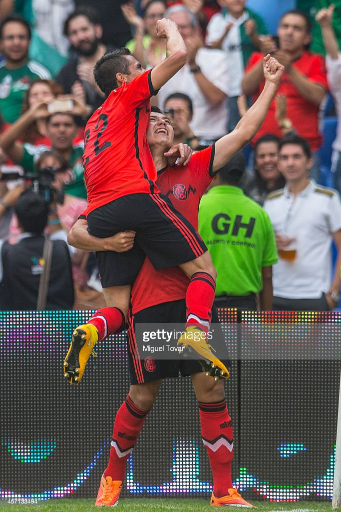Erick Torres of Mexico celebrates after scoring with Paul Aguilar during a friendly match between Mexico and Panama at Corregidora Stadium on October 12, 2014 in Queretaro, Mexico.