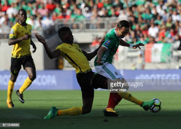 Erick Torres of Mexico competes for the ball with Damion Lowe of Jamaica during a match between Mexico and Jamaica as part of CONCACAF Gold Cup...