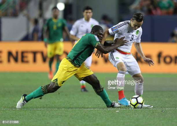 Erick Torres of Mexico competes for the ball with Oniel Fisher of Jamaica during a Group C match between Mexico and Jamaica as part of CONCACAF Gold...
