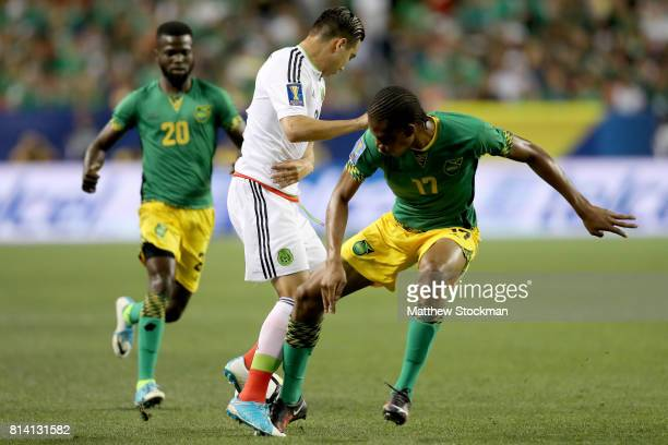Erick Torres of Mexico fights for control of the ball with Kevon Lambert of Jamaica in the first half during the 2017 CONCACAF Gold Cup at Sports...