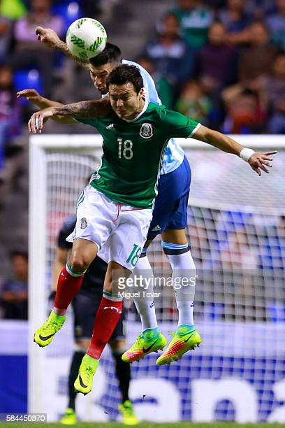 Erick Torres of Mexico fights for the ball with Mauricio Martinez of Argentina during an U23 International Friendly between Mexico and Argentina at...