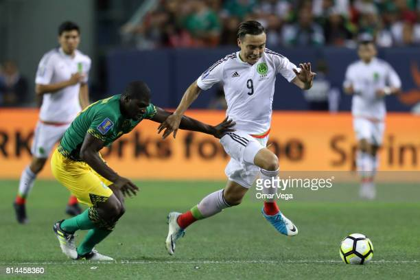 Erick Torres of Mexico fights for the ball with Oniel Fisher of Jamaica during a Group C match between Mexico and Jamaica as part of CONCACAF Gold...