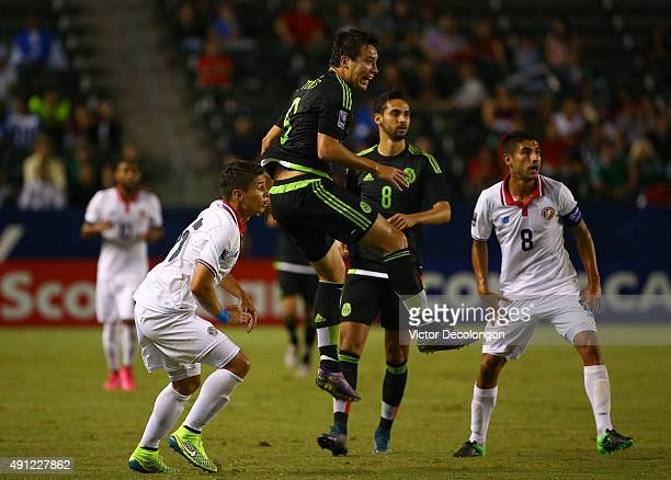 Erick Torres of Mexico in action against Joseph Mora and Luis Sequeira of Costa Rica in the first half during the 2015 CONCACAF Olympic Qualifying...