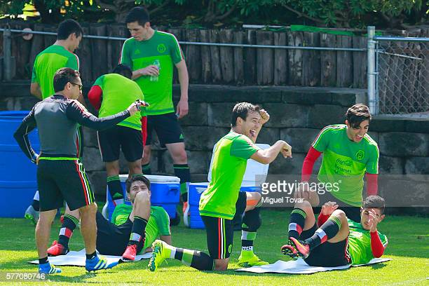 Erick Torres of Mexico jokes with teammates during a training session ahead of the friendly match between Mexico and Argentina at CAR on July 18 2016...