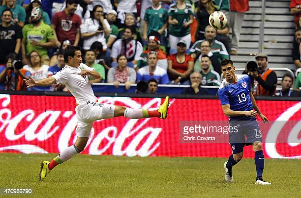 Erick Torres of Mexico kicks the ball past Ventura Alvarado of the United States during an international friendly match at the Alamodome on April 15...