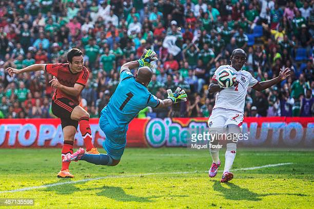 Erick Torres of Mexico scores against Oscar McFarlane goalkeeper of Panama during a friendly match between Mexico and Panama at Corregidora Stadium...