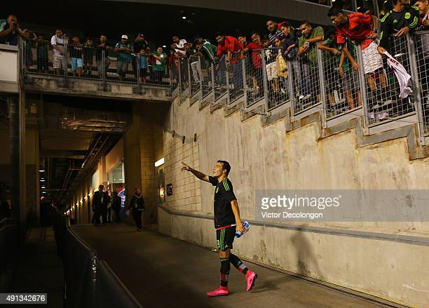 Erick Torres of Mexico talks to a fan in the stands after Mexico defeated Costa Rica 40 in the 2015 CONCACAF Olympic Qualifying Group B match at...