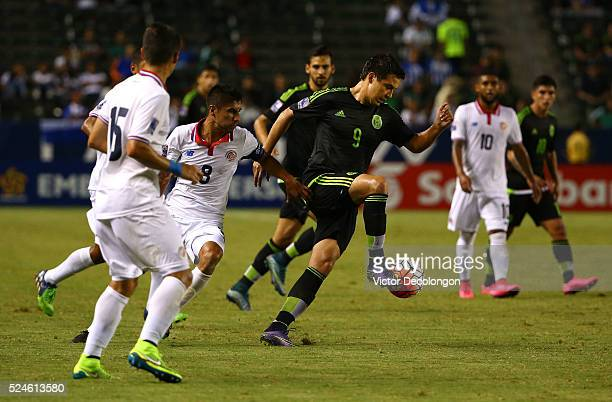 Erick Torres of Mexico wins the ball from Luis Sequeira of Costa Rica in the first half during the 2015 CONCACAF Olympic Qualifying Group B match at...