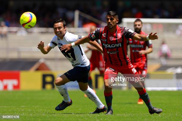 Erick Torres of Pumas fights for the ball with Miguel Ponce of Necaxa during the 13th round match between Pumas UNAM and Necaxa as part of the Torneo...