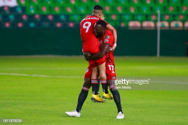 Erickson Gallardo of Toronto celebrates with teammate after Andres Mosquera of Leon scored an own goal during a first leg match of round of sixteen...
