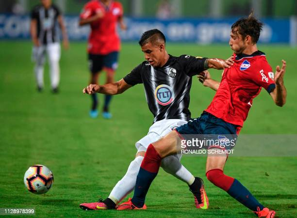 Erickson Gallardo of Venezuela's Zamora vies for the ball with Uruguay's Nacional Matias Vina during their Copa Libertadores 2019 football match at...
