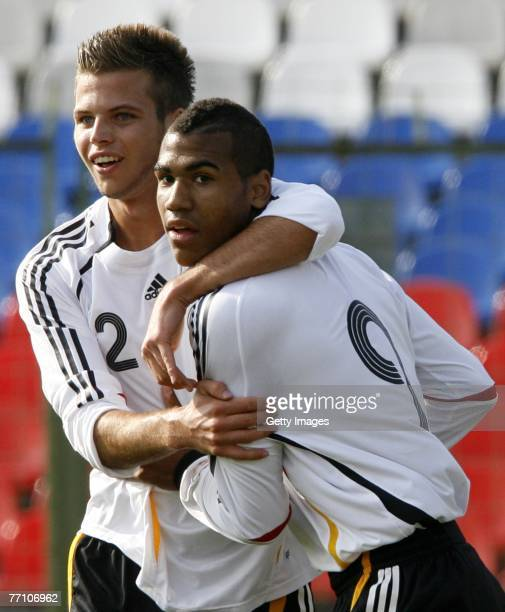 Eric-Matim Choupo-Moting and Dennis Diekneier of Germany celebrate a goal during the U19 Euro qualifying match between Russia and Germany at the...