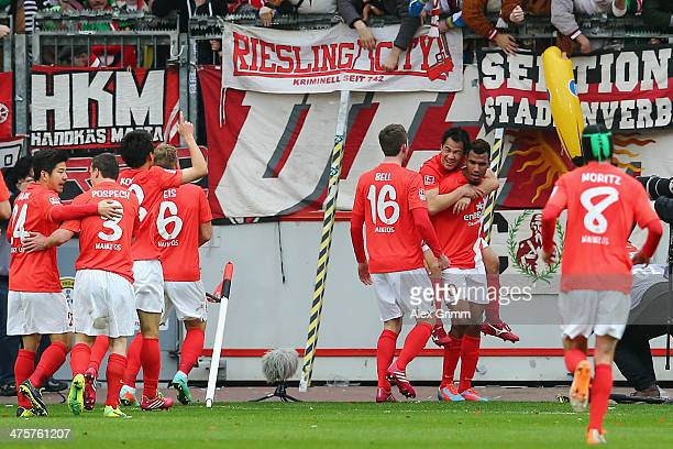 EricMaxim ChoupoMoting of Mainz celebrates his team's first goal with team mates during the Bundesliga match between Bayer 04 Leverkusen and 1 FSV...