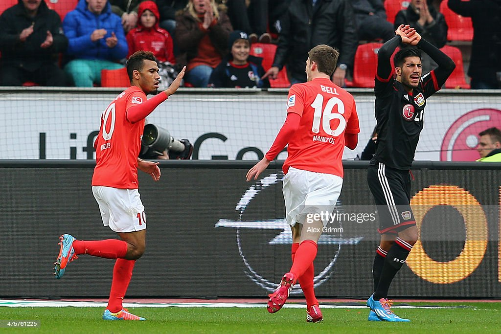 Eric-Maxim Choupo-Moting of Mainz celebrates his team's first goal with team mate Stefan Bell as Emre Can (L-R) of Leverkusen reacts during the Bundesliga match between Bayer 04 Leverkusen and 1. FSV Mainz 05 at BayArena on March 1, 2014 in Leverkusen, Germany.