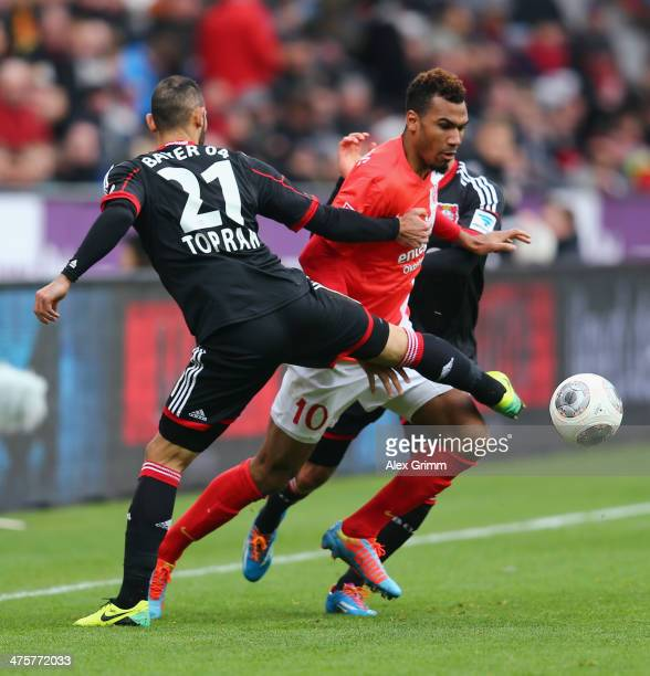 EricMaxim ChoupoMoting of Mainz is challenged by Emre Can and Oemer Toprak of Leverkusen during the Bundesliga match between Bayer 04 Leverkusen and...