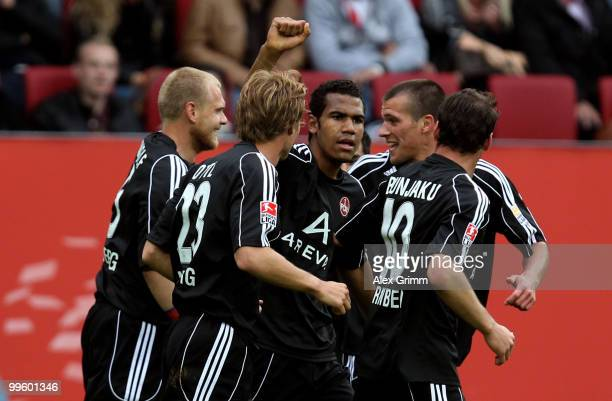 EricMaxim ChoupoMoting of Nuernberg celebrates his team's second goal with team mates during the Bundesliga play off leg two match between FC...