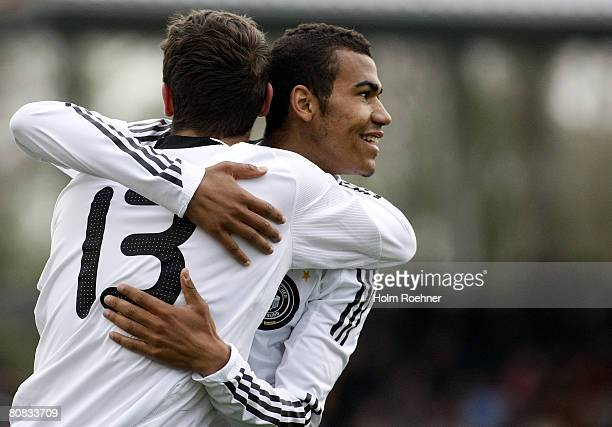 EricMaxim Moting and Semih Aydilek of Germany celebrate a goal during the men's Under 19 friendly match between Germany and Serbia at the Stadium...