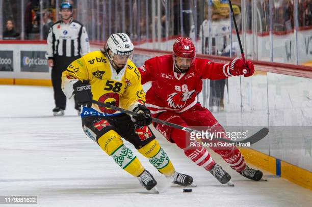 Eric-Ray Blum of SC Bern fights for the puck with Matteo Nodari of Lausanne HC during the Swiss National League game between Lausanne HC and SC Bern...