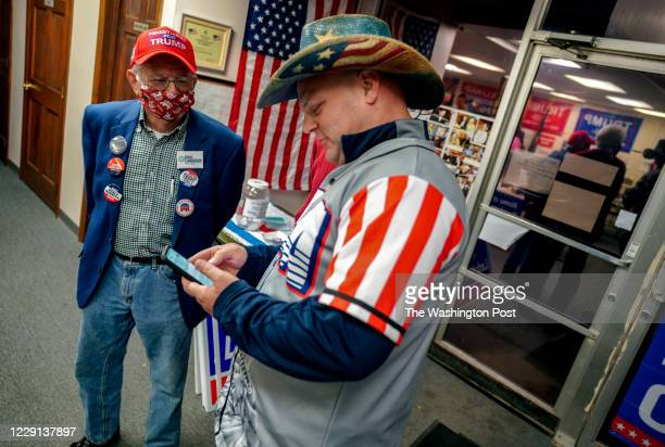 Erie County Republican Party Chairman Verel Salmon socializes with Trump supporter Chris Work during a gathering in Erie, Pennsylvania, on October...