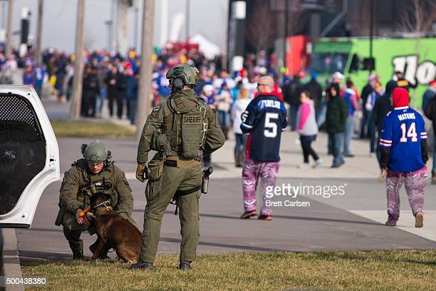 Erie County Sheriff swat officers patrols the exterior of the stadium before the game between the Buffalo Bills and the Houston Texans on December 6...
