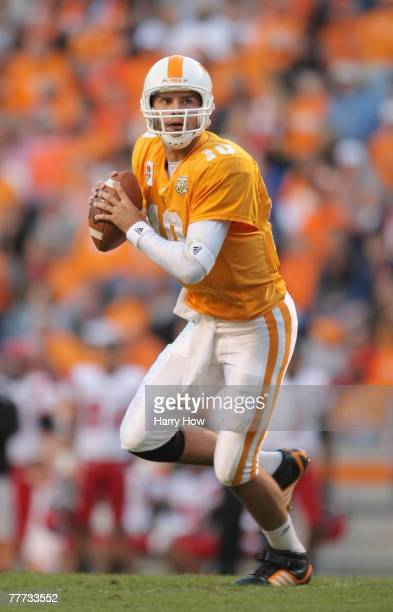 Erik Ainge of the Tennessee Volunteers rolls out of the pocket against the Louisiana Lafayette Cajuns during the third quarter at Neyland Stadium on...
