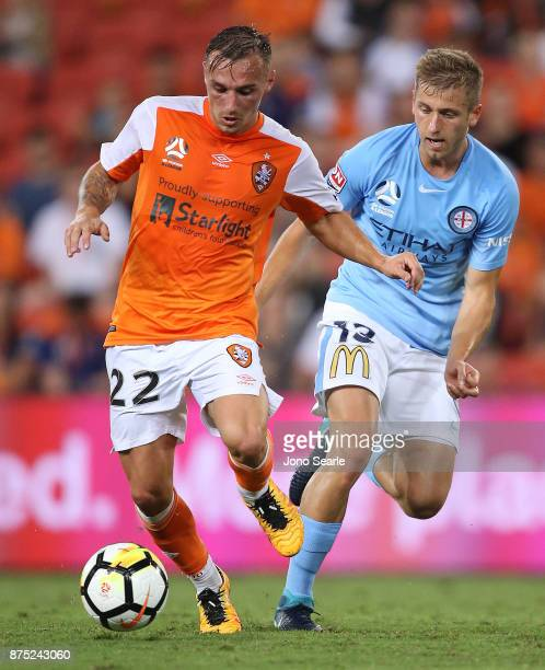Erik Bautheac of Brisbane and Stefan Mauk of Melbourne compete for the ball during the round seven ALeague match between Brisbane Roar and Melbourne...
