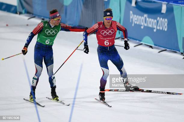 Erik Bjornsen of the United States and Simeon Hamilton of the United States handover during the Cross Country Men's Team Sprint Free Final on day 12...