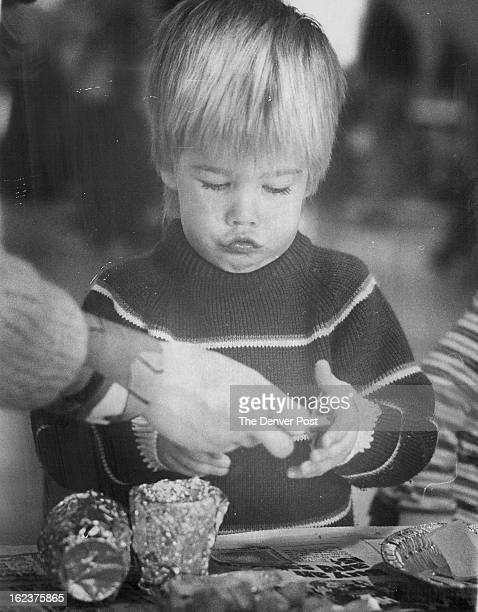 DEC 19 1975 Erik Boar grimaces as he concentrates in making a Christmas decoration at First Plymouth Congregational Church 3501 S Colorado Blvd...