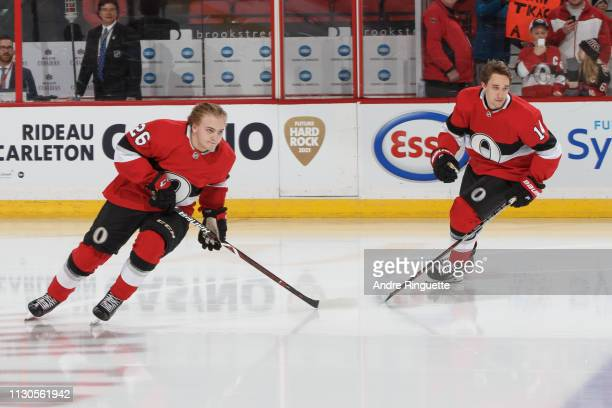 Erik Brannstrom and Max Veronneau of the Ottawa Senators are made to take a warmup lap alone as part of tradition for players making their NHL debut...