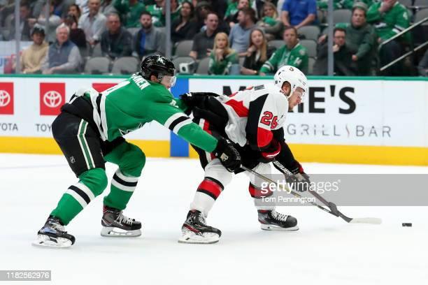 Erik Brannstrom of the Ottawa Senators controls the puck against Miro Heiskanen of the Dallas Stars in the second period at American Airlines Center...