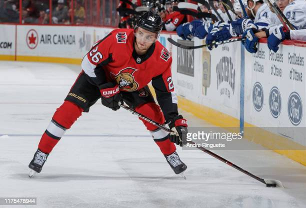 Erik Brannstrom of the Ottawa Senators controls the puck against the Tampa Bay Lightning at Canadian Tire Centre on October 12 2019 in Ottawa Ontario...