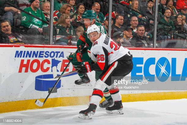 Erik Brannstrom of the Ottawa Senators defends Eric Staal of the Minnesota Wild during the game at the Xcel Energy Center on November 29 2019 in...