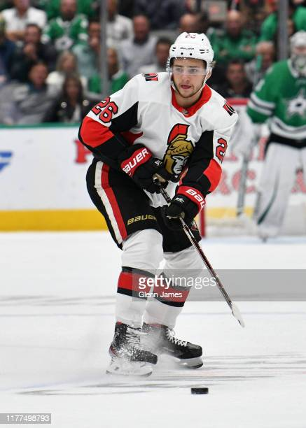 Erik Brannstrom of the Ottawa Senators handles the puck against the Dallas Stars at the American Airlines Center on October 21 2019 in Dallas Texas