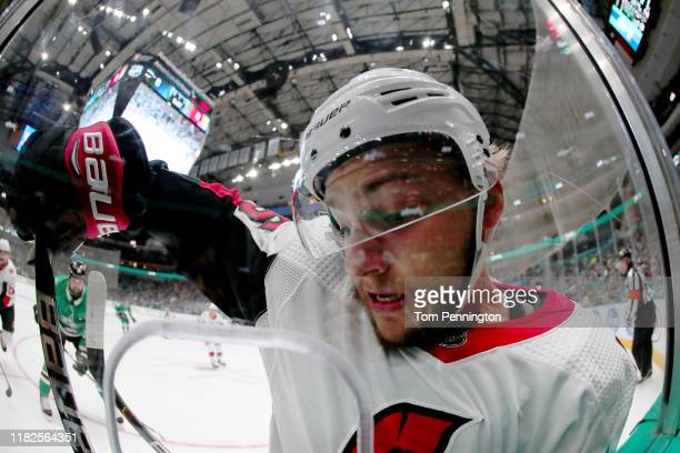 Erik Brannstrom of the Ottawa Senators is checked into the glass by Corey Perry of the Dallas Stars in the first period at American Airlines Center...