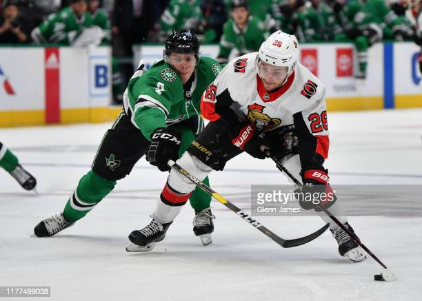 Erik Brannstrom of the Ottawa Senators tries to keep the puck away against Miro Heiskanen of the Dallas Stars at the American Airlines Center on...