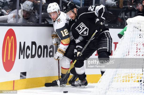 Erik Brannstrom of the Vegas Golden Knights and Trevor Lewis of the Los Angeles Kings battle for the puck during the third period of the game at...