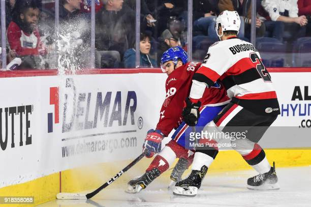 Erik Burgdoerfer of the Belleville Senators challenges Jordan Boucher of the Laval Rocket during the AHL game at Place Bell on February 14 2018 in...