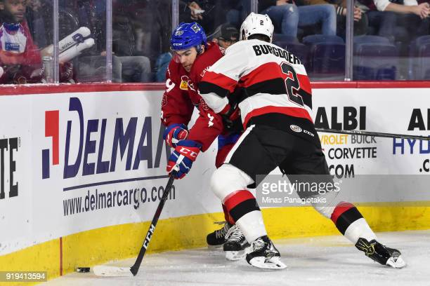 Erik Burgdoerfer of the Belleville Senators pins Jordan Boucher of the Laval Rocket against the boards during the AHL game at Place Bell on February...