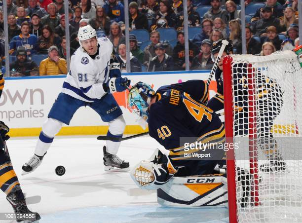 Erik Cernak fires the puck against Carter Hutton of the Buffalo Sabres during an NHL game on November 13 2018 at KeyBank Center in Buffalo New York