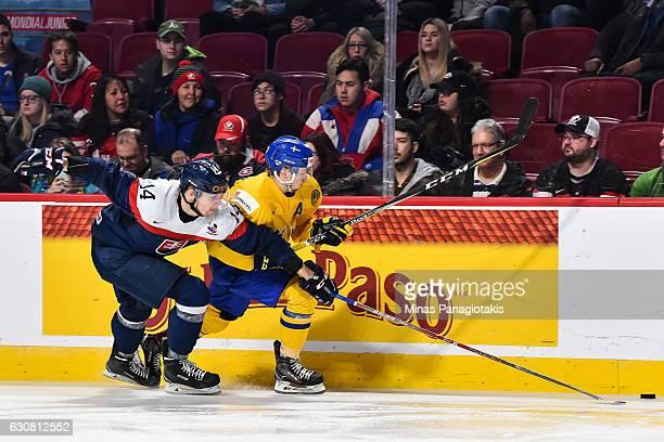 Erik Cernak of Team Slovakia challenges Rasmus Asplund of Team Sweden during the 2017 IIHF World Junior Championship quarterfinal game at the Bell...