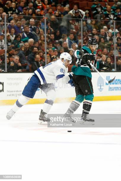 Erik Cernak of the Tampa Bay Lightning and Andrew Cogliano of the Anaheim Ducks fight for control of the puck during the second period at Honda...