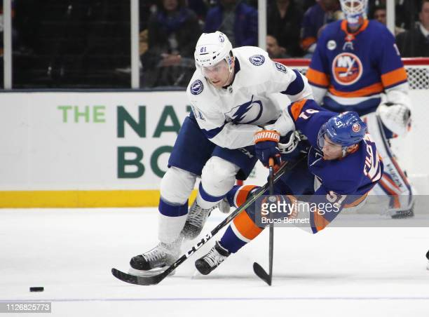 Erik Cernak of the Tampa Bay Lightning and Valtteri Filppula of the New York Islanders battle for the puck during the third period at NYCB Live's...